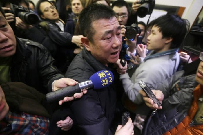 A relative of a passenger of Malaysia Airlines flight MH370 speaks to journalists in Beijing